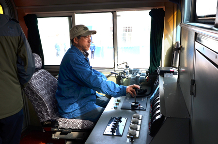 Train engineer in a train cockpit