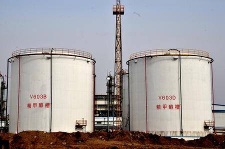 Methanol storage tank in an industrial area