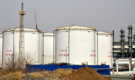 Methanol storage tank in an industrial area