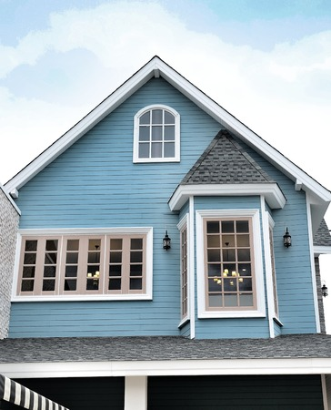 Average family house with blue sky background photo