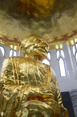 Gold buddha statue in thai temple, Thailand