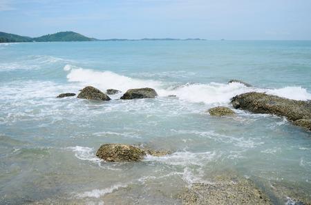 onto: Waves crashing onto rocks Stock Photo