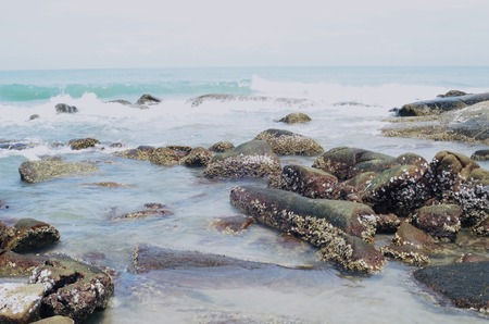 waves crashing: Waves crashing onto rocks Stock Photo