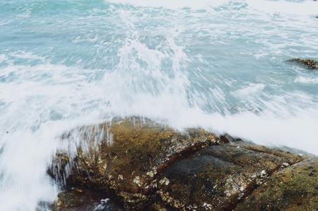 crashing: Waves crashing onto rocks in the sea