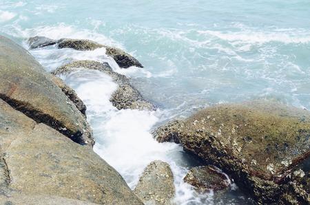 waves crashing: Waves crashing onto rocks in the sea