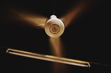 ceiling fan: Moving ceiling fan in room Stock Photo