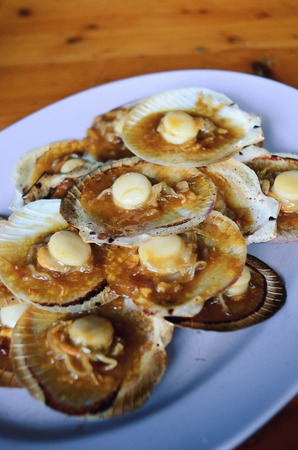coquille: Grilled scallops topped with butter, garlic and onion