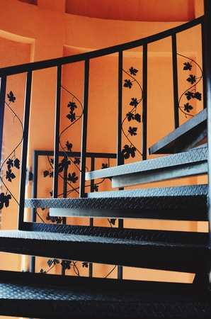 grape leaves: Metallic grape leaves and ornaments on door staircase