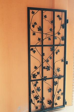 grape leaves: Metallic grape leaves and ornaments on door