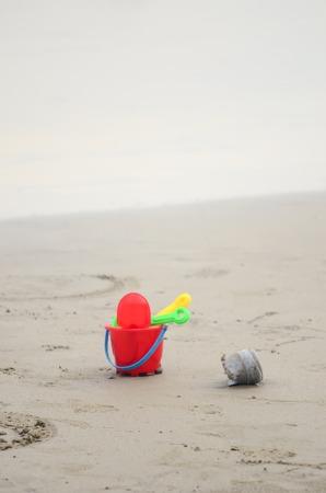 plastic toys: colorful plastic toys on the beach near the sea