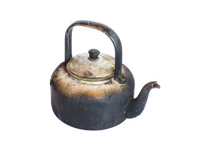 Old kettle on a white background photo