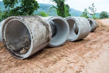 Concrete drainage pipe on a construction site in Thailand photo
