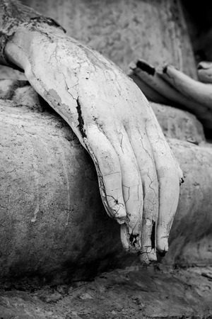 Closeup of the fingers of a Buddha statue photo