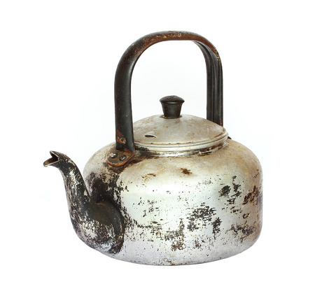 Old kettle on a white background