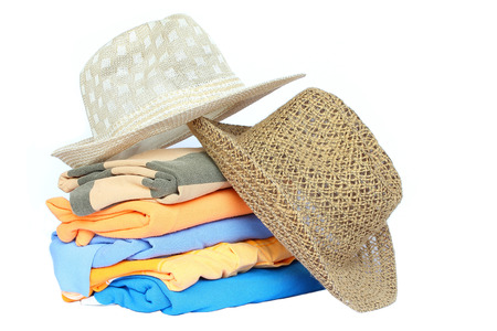 Pile of colorful clothes with a hat over white background  photo