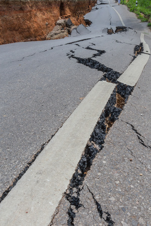 layer of broken asphalt road at rural areas Stock Photo