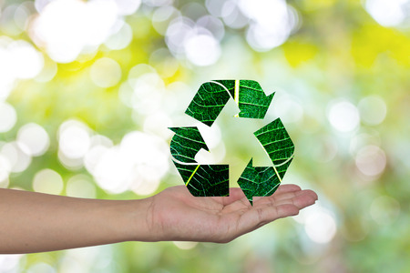 Recycling arrows made of green leaf on woman hands  Ecology Concept.Environment ally friendly. Imagens - 30347119