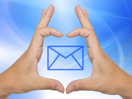 Human hand presenting futuristic transparent mail icon photo