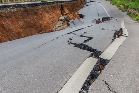 areas: layer of broken asphalt road at rural areas Stock Photo