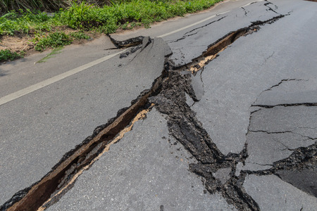 layer of broken asphalt road at rural areas photo