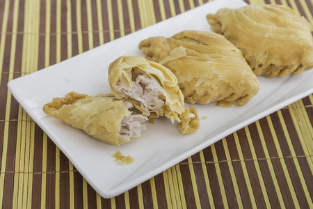 Curry puff on bamboo mat Stock Photo