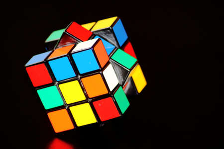 Rubiks cube isolated on black background Editorial