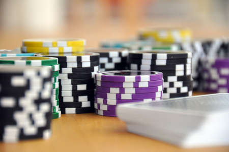 Gaming chips and a deck of playing cards