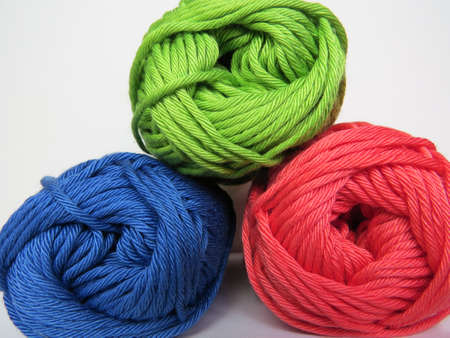 Knitting wool ball sweater red, green and blue Stock Photo
