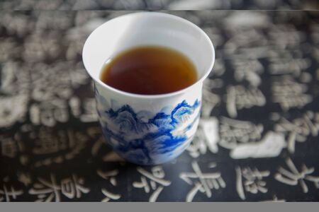 black tea in Chinese blue and white porcelain tea cup