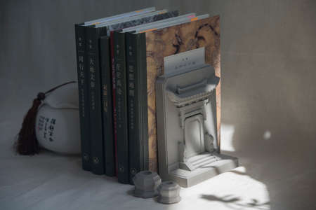 Grey cement Chinese traditional building door shape bookend Editorial
