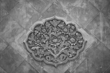Brick carving pattern on gray brick shadow wall in Chinese garden