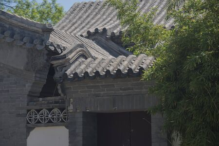 Traditional courtyard house in Chinese garden, scattered houses and ridges in the courtyard