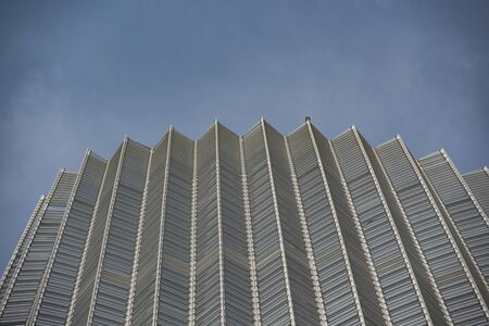 Close-up of the top shape of the high-rise modern building in the city center