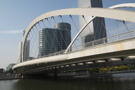 Close-up of modern bridge buildings in the city center and urban landscape on the river bank