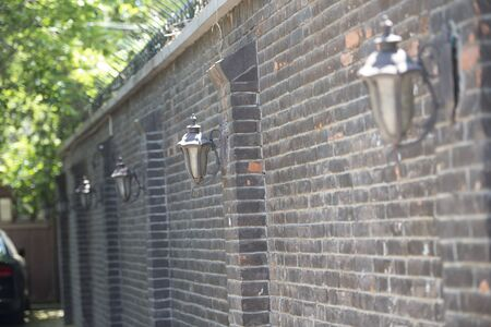 Red brick fence and street lamp in the quiet alley