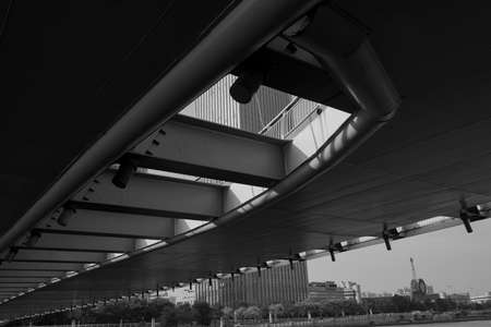 Close-up view of the bottom of modern bridge building in the city center