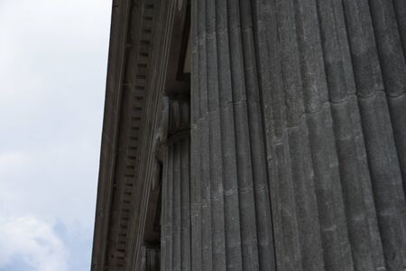 Stone columns and decorative patterns of stone carvings on tall European old buildings