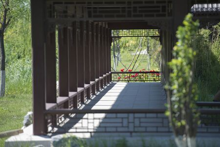 Wooden structure viewing corridor in Chinese garden