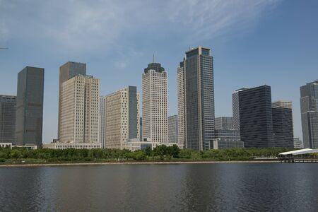 Modern commercial buildings along the Haihe River in Tianjin Binhai New Area