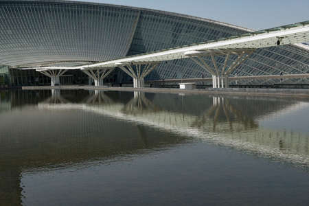 Reflection of the promenade in front of Urban modern architecture in the water 新聞圖片