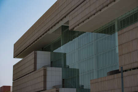 The extension of modern urban buildings is simple and powerful lines and glass curtain wall
