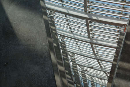 Urban modern building glass roof and stone pillars