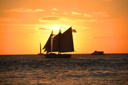Key West Sunset and sailing boat, Key West, Florida, USA photo