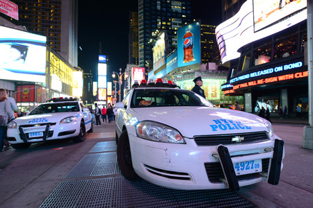 NYPD police car in Times Square at night, Manhattan, New York City, USA
