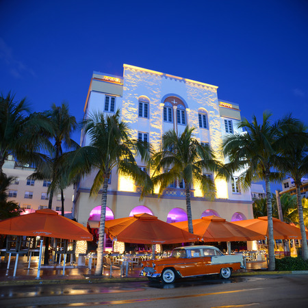 miami south beach: Edison Hotel with Art Deco Style Building and antique Chevrolet Bel Air in Miami Beach at night, Miami, Florida, USA. Edison Hotel on Ocean Drive is Art Deco with Mediterranean Revivalism style, is one of the most famous architecture in South Beach.