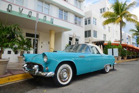 thunderbird: 1957 Ford Thunderbird in front of Art Deco style Avalon Hotel in Miami Beach, Florida, USA Editorial