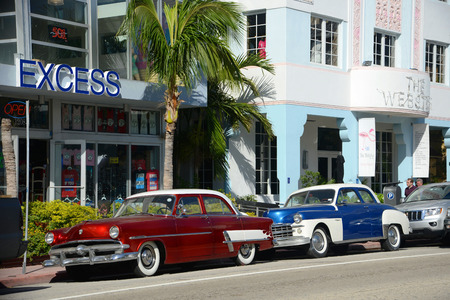 excess: 1952 Ford Customline in Miami Beach in front of Art Deco style Excess Building in Miami Beach, Florida, USA Editorial