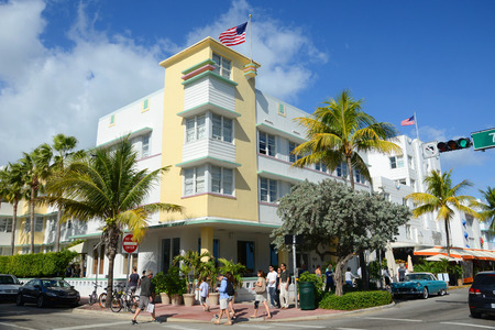 Art Deco Style Building Avalon and yellow cab in Miami Beach in the morning, Miami, Florida, USA.