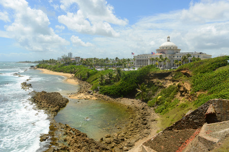 capitolio: Puerto Rico Capitol (Capitolio de Puerto Rico) and Rocky Coast, viewed from Castillo de San Cristobal, San Juan, Puerto Rico. Stock Photo