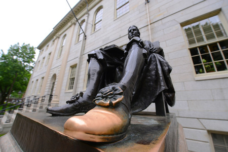Wide angle of John Harvard statue in Harvard University, Cambridge, USA